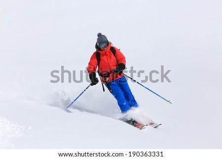 Smiling woman skiing in the Utah mountains, USA.