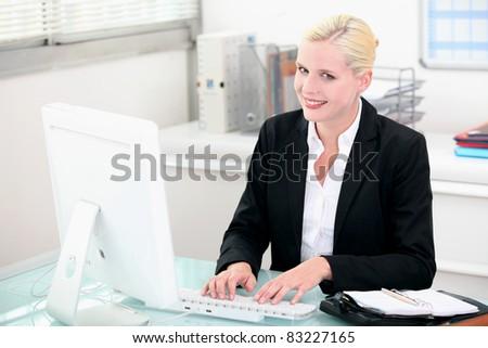 Smiling woman typing on keyboard