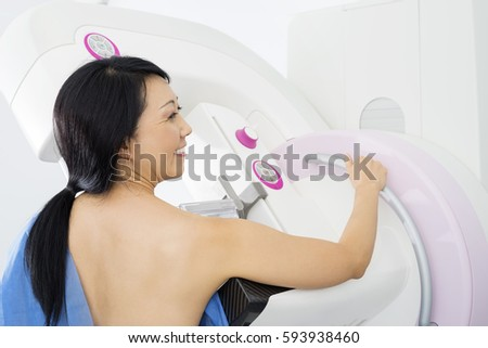 Smiling Woman Undergoing Mammogram X-ray Test
