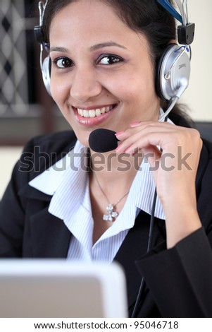 Smiling Woman wearing headset in office