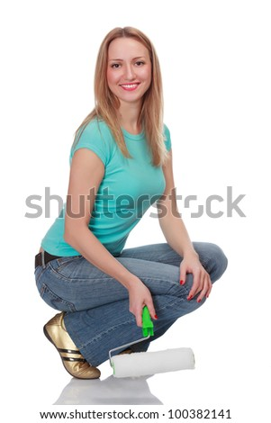 Smiling woman with a brush against the white background.