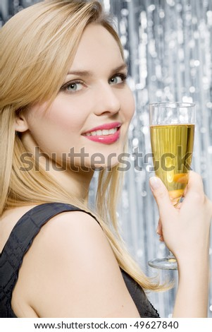 Smiling woman with glass of champagne
