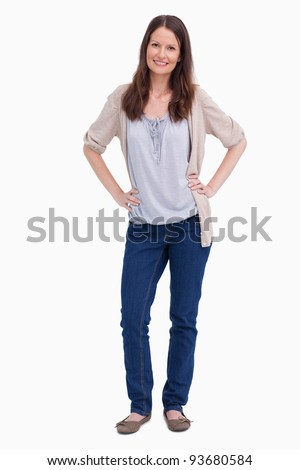 Smiling woman with her hands on her hip against a white background