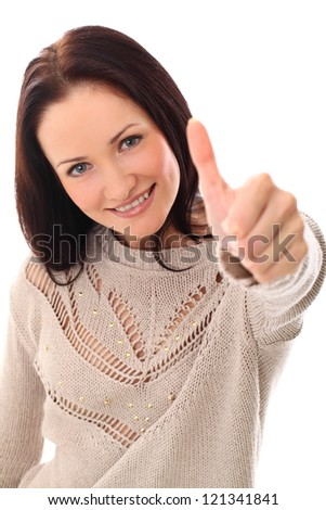 Smiling woman with long hair pointing at you over a white background