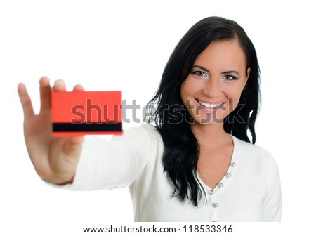 Smiling woman with red credit card. Isolated on white.