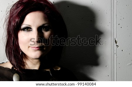 Smiling woman with screaming shadow