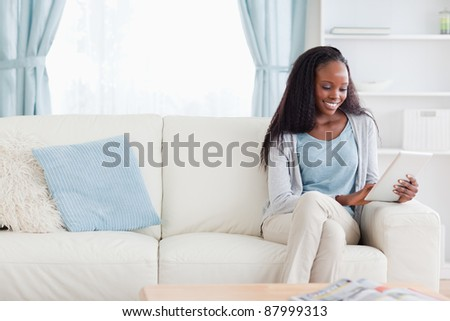 Smiling woman with tablet stock photo