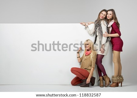 Smiling women with empty board
