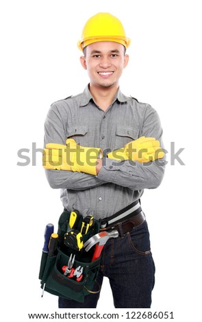 smiling worker crossed his arms and bring equipment ready to work