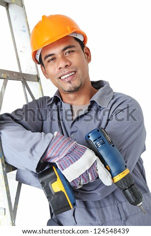 Smiling worker leaning on a ladder.