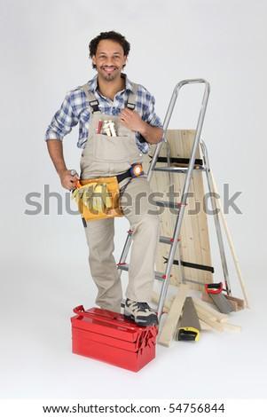 Smiling workman on white background