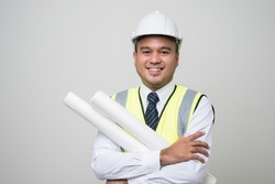 Smiling young asian civil engineer helmet hard hat standing showing thumbs up on isolated white background. Mechanic service concept.