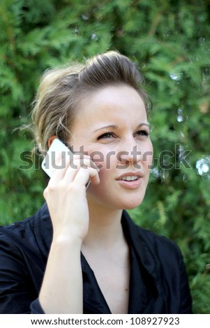 Smiling Young Attractive Businesswoman On the Phone