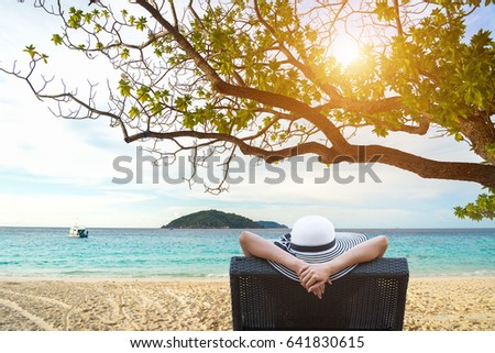 Smiling Young attractive woman relaxing on luxury beach with cocktail.  Summer Concept #641830615