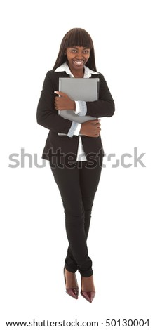 Smiling young black female student with closed laptop against chest
