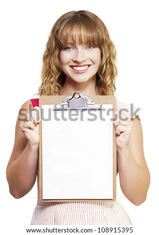 Smiling young blonde secretary or personal assistant holding up a clipboard with a blank sheet of white paper for your announcement or advertisement isolated on white