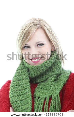 Smiling young blonde woman in a warm green knitted winter scarf isolated on white