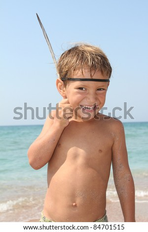 smiling young boy on sea background