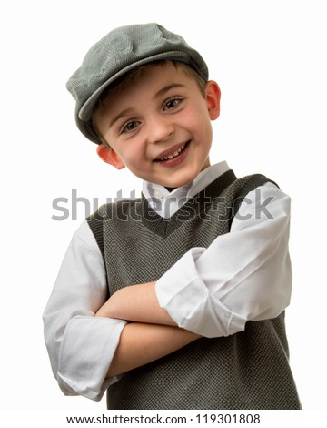 Smiling young brunette caucasian boy with arms crossed wearing a flat cap