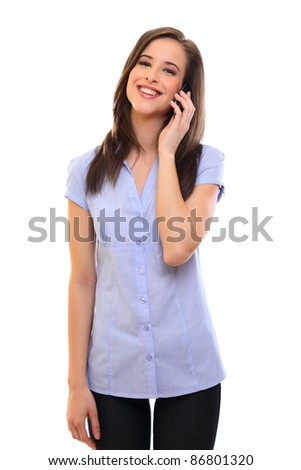 smiling young brunette woman talking on cellphone