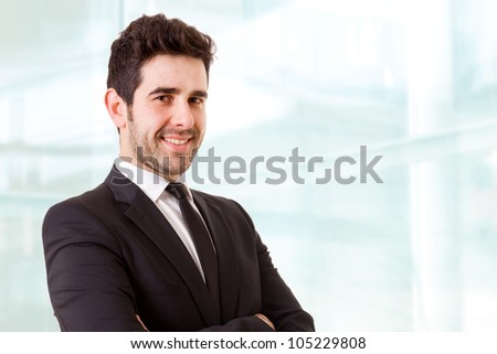 Smiling young business man at the office