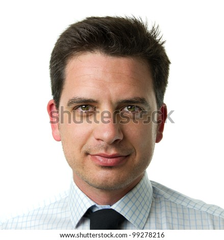 Smiling young business man. Close up portrait over monochrome white background
