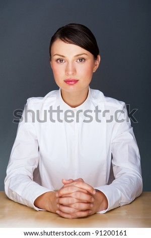 Smiling young business woman. In a modern office.