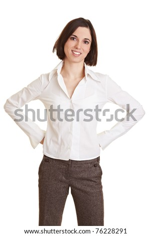 Smiling young business woman with her arms akimbo