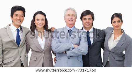 Smiling young businessteam with their mentor against a white background - stock photo