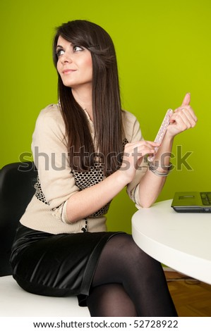 Smiling young businesswoman or office worker filing fingernails at work