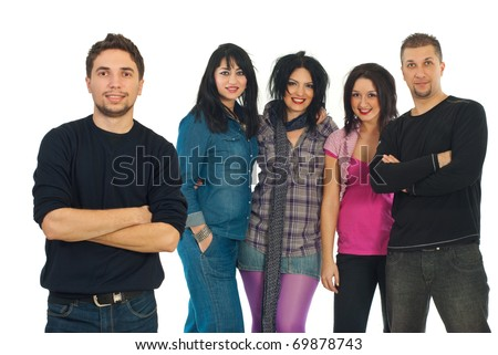 Smiling young casual man standing with arms folded in front of camera and his best friends smiling on background