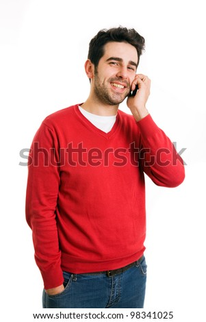 Smiling young casual man talking on the phone isolated on white background