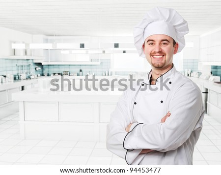 smiling young chef in modern kitchen