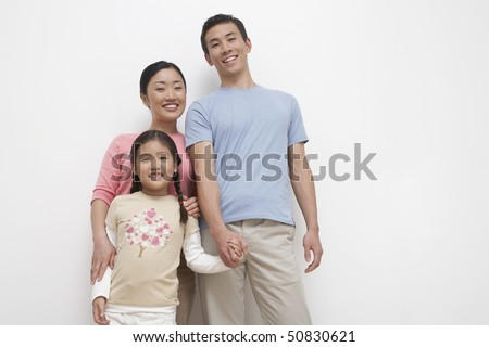 Smiling Young couple and daughter family portrait, low angle view