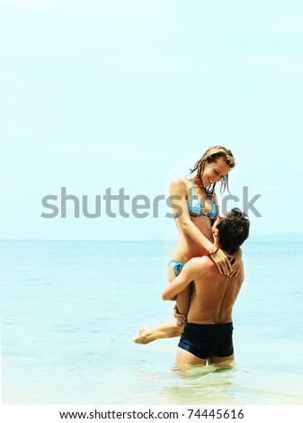 Smiling young couple in the sea