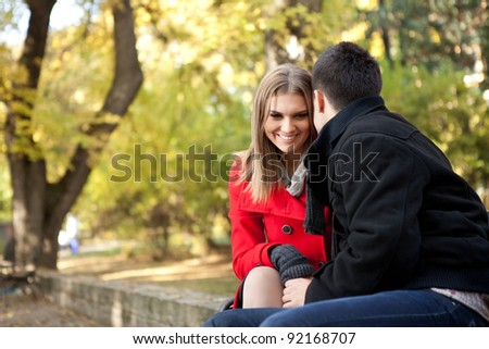 smiling young couple talking, time for flirting, outdoor