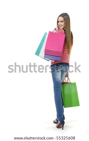 smiling young female posing with shopping bags isolated on white