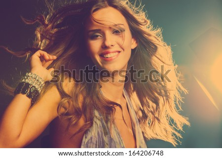 smiling young girl dancing in night club, retro colors