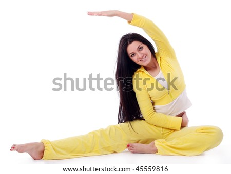 smiling young girl doing fitness exercises
