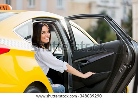 Smiling young girl in a taxi