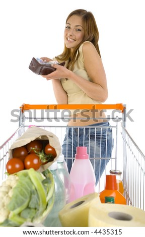 Smiling, young girl with trolley. Holding full of money wallet. Looking at camera. White background, front view