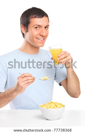 Smiling young male at breakfast isolated on white background