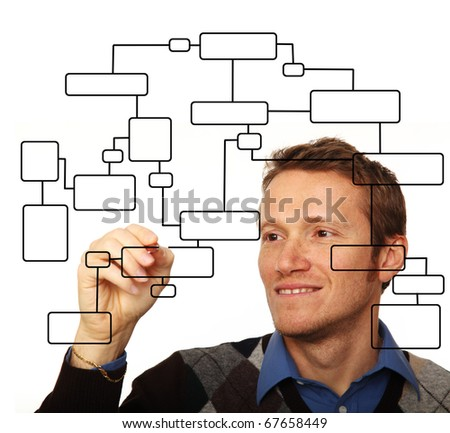 smiling young man drawing flowchart on glass board