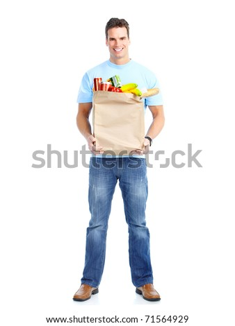 smiling young man holding a shopping bag with food