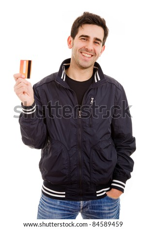Smiling young man holding credit card, isolated on white
