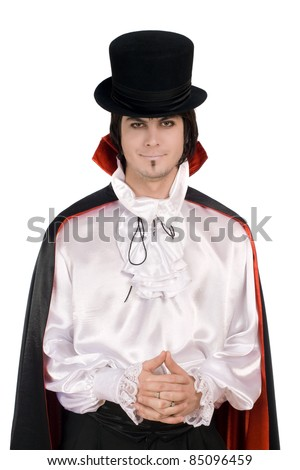 Smiling young man in a suit of Count Dracula