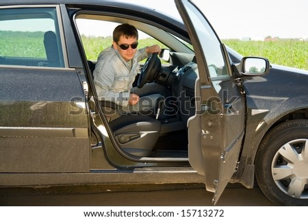 smiling young man in the car