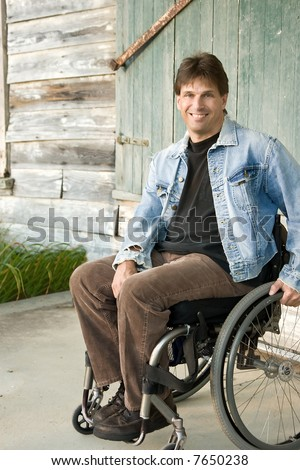 smiling young man in wheelchair