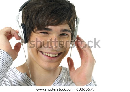 Smiling young man listening to music-close up