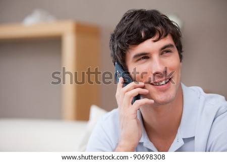 Smiling young man on the phone